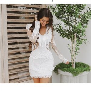 Brand new White lace mini dress with fringe detail